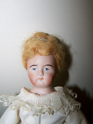 Bisque 8 inch shoulder head doll painted eyes