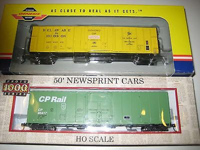 4 HO scale wagons - 2 50' boxcars 1 coil steel car & 1 mill gondola