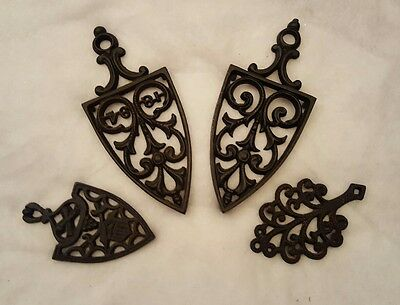 Lot of 4 Vintage Cast Iron Footed Trivets WILTON