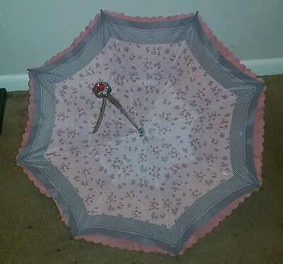 Parasol made in Italy. Pink and floral. Sun umbrella.