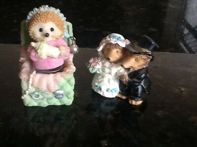 Hedgehog pottery figures, bouncing baby and married couple.