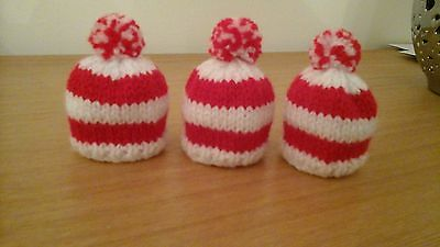 3 red and white egg cosies (football colours)