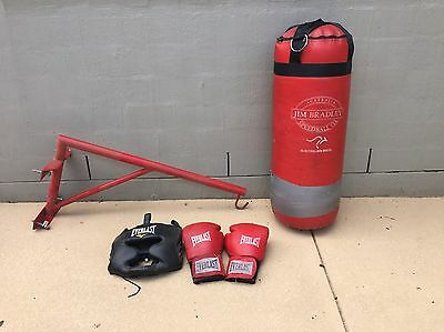 Boxing bag with wall bracket and gloves