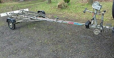 Fishing boat punt and Snipe boat trailer. 3.5hp 4 stroke Tohatsu outboard motor
