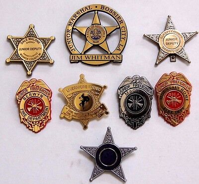 8 Different Police & Firefighter Plastic Badges Pins