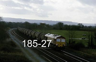 Original 35mm colour slide of 66179 at Charlton with a china clay train (185-27)