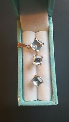 9ct gold Aquamarine  Pendant  & earrings set,  excellent condition.