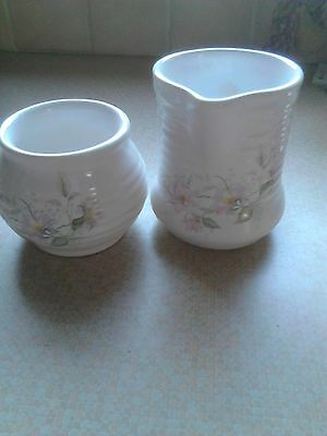 dunmead pottery jug and sugar bowl with partial floral pattern