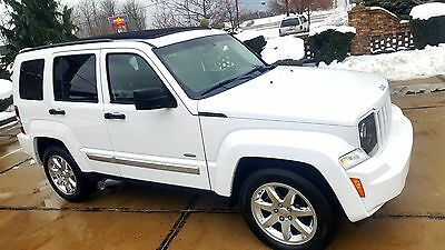 """2012 Jeep Liberty Latitude 4x4  """" Sky slider full open roof """" 4x4 Latitude Sky slider roof Leather heated seats Chrome wheels Touch screen A-1"""