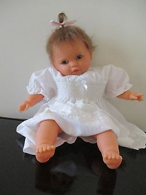 Lovely Reborn Baby Doll soft weighted body and rooted hair.