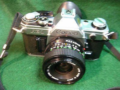 CANON AE-1 35mm SLR FILM CAMERA BLACK & SILVER BODY +1 LENS FOR PARTS OR FIX