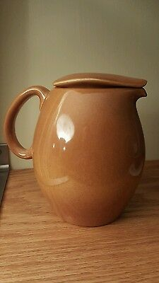 Russel Wright Iroquois Casual Ripe Apricot  Pitcher with lid.