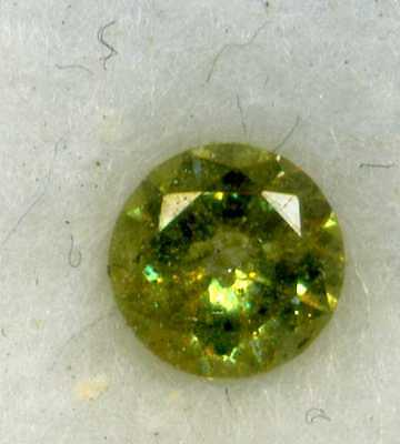 DEMANTOID URAL 0.25CT with the usual 'tail'