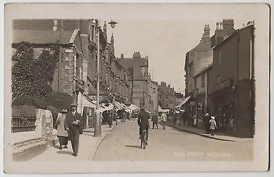POSTCARD - Gold Street Kettering, animated street scene shop fronts bicycle, RP