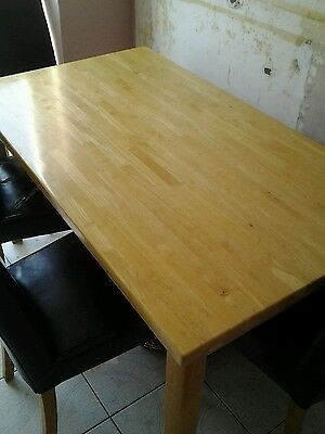 Solid wooden table and four leather chairs