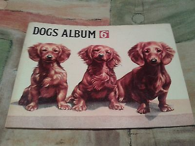 Hornimans Tea Cards Dogs album contains incomplete set of cards