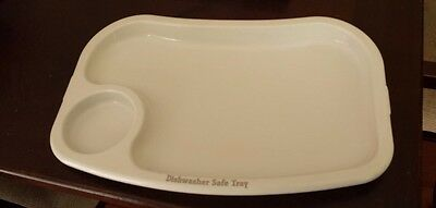 White feeding tray insert of Fisher Price deluxe Healthy Care Booster seat chair