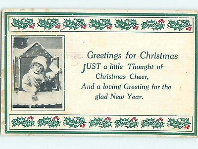 Pre-Linen christmas CHILD IN THE WINDOW HOLDING CARD hk9779