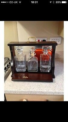 Wooden Tantalus And 3 Decanters