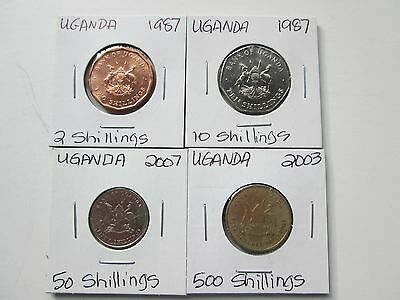 UGANDA:  4 coins, 1987-2007, Circulated to Uncirculated,  Carded
