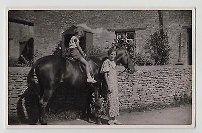 POSTCARD - social history, woman standing with girl child on horse, real photo