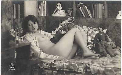 1920 French NUDE Photograph - Flapper Smoking on Sofa, Toy Doll, Art Deco