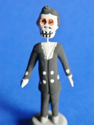 REDUCED!!  Day of the Dead Minature Clay Skeleton Hotel Porter