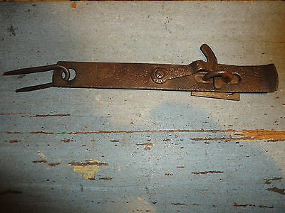 Antique wrought iron door hasp with staples and keeper