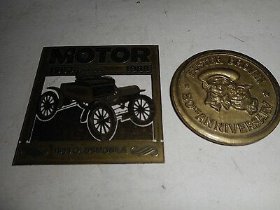 Buster Brown Shoes 50th Anniv. Plastic Token & Oldsmobile 85th Anniv. Brass Tag