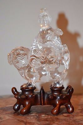 An 18th century Chinese carved rock crystal figure of a wise man