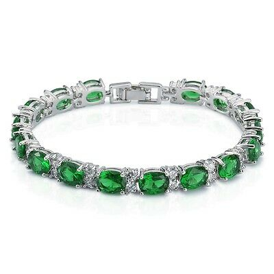 Silver, Oval Shaped Emerald & White Topaz 11ct Tennis Bracelet 7""