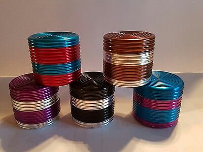 Metallic 4 part 35mm alloy rippled tobacco grinders.