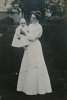 ANTIQUE PHOTO MOTHER holding BALD CONEHEAD BABY In Yard