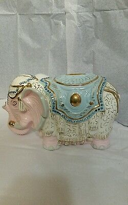 Stunning white,pink,blue porcelain good luck trunk up  elephant.