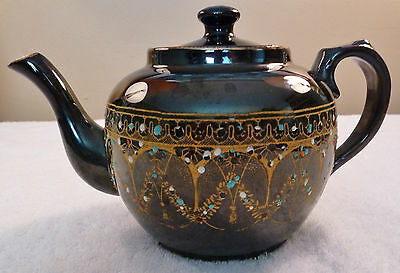Victorian-style black English teapot, gold garlands, colorful enamel beading