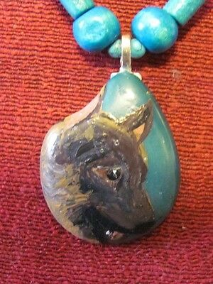 Belgian Malinois hand painted on a Tagua Nut pendant/bead dyed turquoise