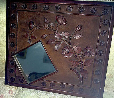 Beautifully carved antique mirror with flowers and leaves