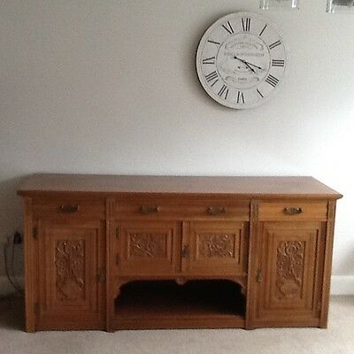 Large ornately carved antique sideboard