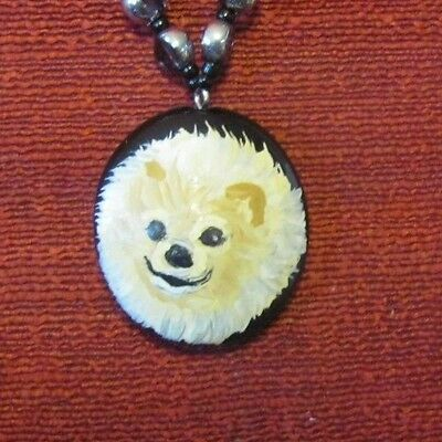 Pomeranian hand painted on round pendant/bead/necklace
