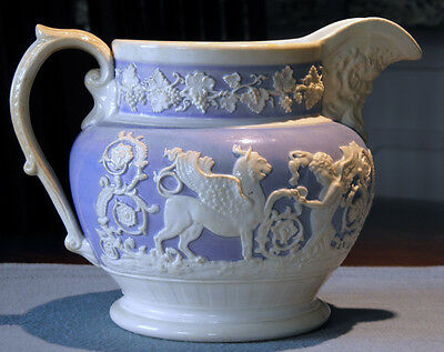 Blue and white decorative pitcher with classical relief decorations