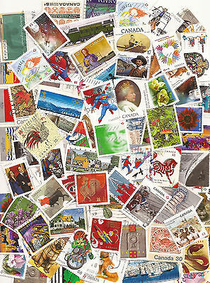 Lot#CL Mix of 100 Canada used stamps off paper - mainly large stamps