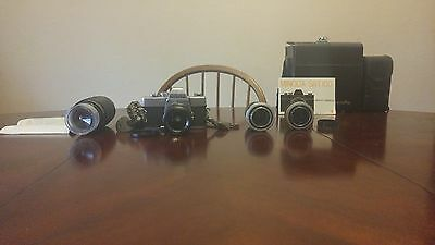 Minolta SRT-100 Camera Lot FOR SALE. EXTRA LENSES AND CARRYING CASES INCLUDED!
