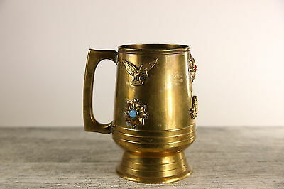 Vintage brass drinking stein with glass gemstone and animal ornaments