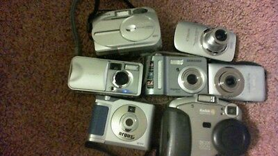 2 Pounds, 14 Ounces Lot Of Digital Cameras (Used, Untested)