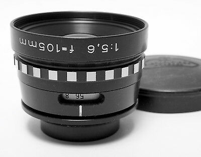 Rodenstock 105mm f/5.6 Rodagon.  Optical defects in rear group.