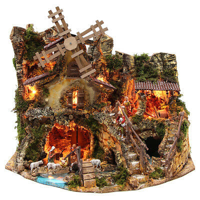 Illuminated nativity setting with stable, houses and mill 42x59x35cm