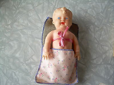 """Vintage 7"""" Rubber Doll (2 pc, Body 1 pc. & head)  Rubber in good condition.."""