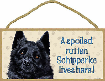 A spoiled rotten Schipperke lives here! Wood Puppy Dog Sign Plaque Made in USA