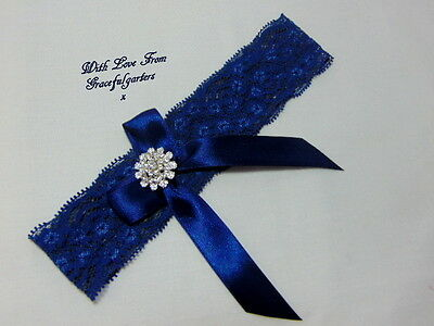 Navy blue stretch bridal wedding garter with brooch and bow