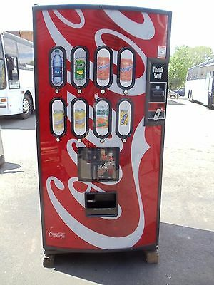 Royal RVCC 660-8 soda/beverage vending machine with chameleon front Coke graphic